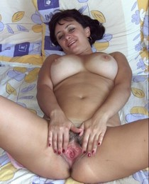 Busty mature woman showing her tight pink vagina