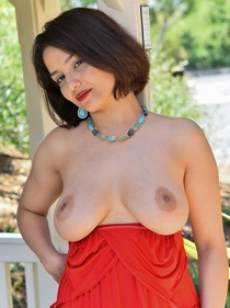 Lush and beauty MILF Mitzi pulls down her red dress and bares her natural big boobs